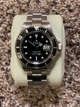 """Rare """"flat S"""" 2006 Rolex Submariner Date 16610 T Stainless No Holes Watch."""