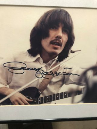 The Beatles George Harrison Signed / Autographed Picture.  8x10 Framed.